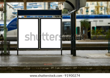 Empty blank billboard at train station - stock photo