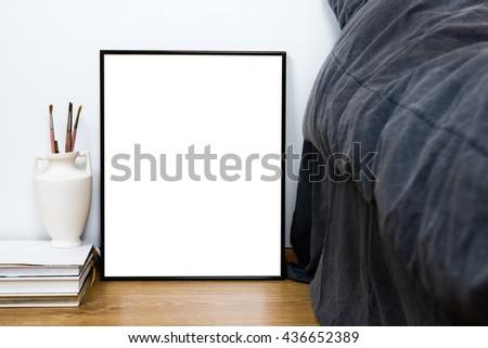Empty blank classic black frame on a floor, minimal home bedroom - stock photo