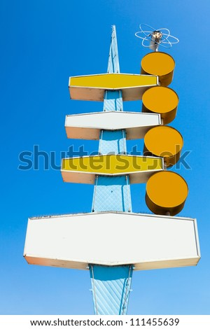 Empty blank retro vintage 1950s or 1960s 4-tier sign from a California burger drive-in restaurant, against bright blue clear sky.  Up to eight customizable copy spaces on this great old sign. - stock photo