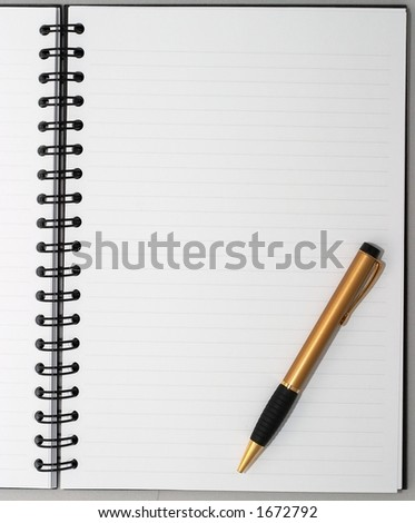 Empty blank ring, spiral notepad, one stylish gold pen on bottom right
