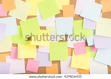 Empty blank sticky notes on notice board in office. Background or backdrop for business information. Concept image of communication or reminder with copy space.  - stock photo
