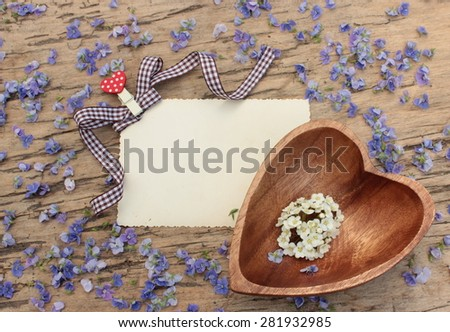 Empty blank with floral background on vintage wooden table