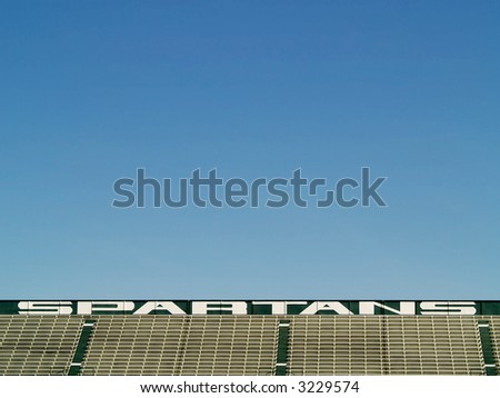 empty bleachers in Spartans sports stadium - stock photo