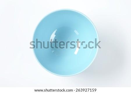 empty blue bowl on white background - stock photo