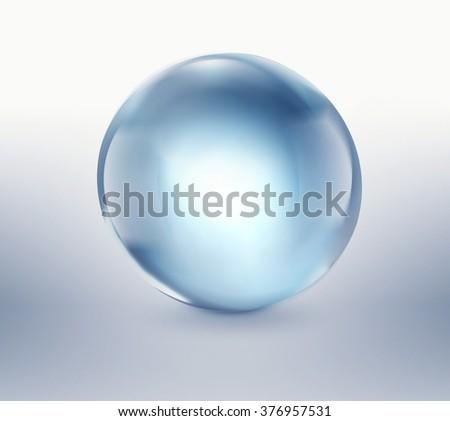 empty blue glass ball on light background - stock photo