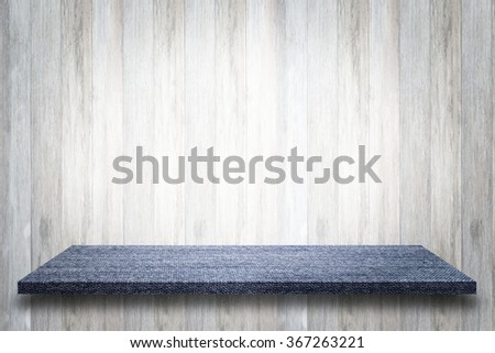 Empty  blue jean table or jean shelf wall on wooden background, For present your products. - stock photo