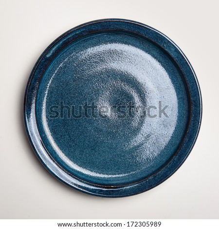 Empty blue plate handmade isolate on white background. - stock photo