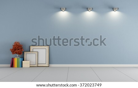 Empty blue room with blank frame and books on floor - 3D Rendering - stock photo