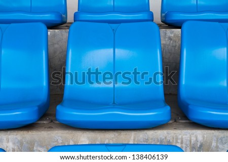 Empty blue seats in stadium - stock photo