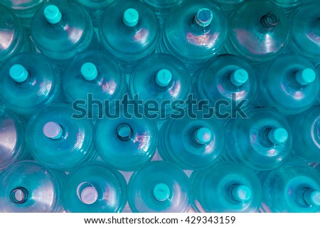 empty blue transparent waters gallon, Overlapping background, blue tone - stock photo