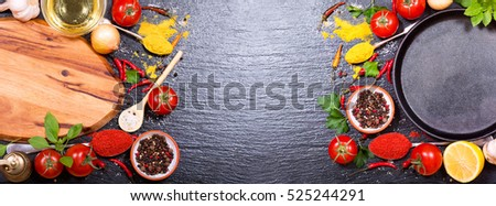 empty board and pan with various products for cooking on dark board, top view with copy space, banner