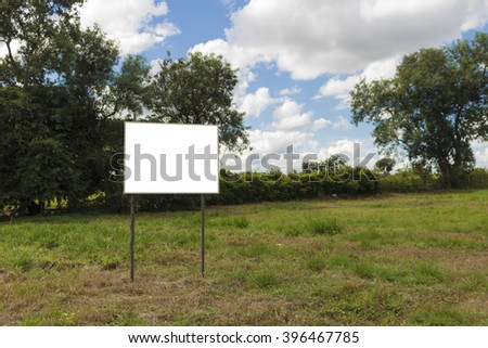 Empty board in front of beautiful cloudy sky in a rural location