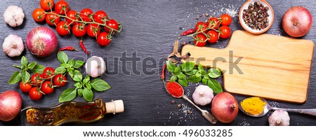 empty board with various products for cooking on dark board, top view, banner