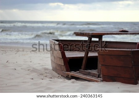 empty boat (bench) on the shore of the Baltic Sea in Poland /empty boat on the seashore - stock photo