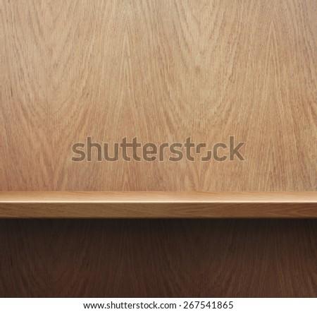 Empty bookshelf or shelf on wooden wall background - stock photo
