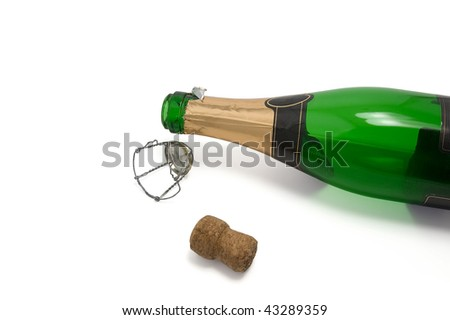 Empty bottle of champagne after the New Year's Eve - stock photo