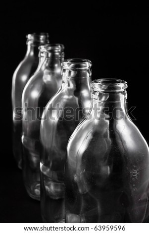 empty bottles collection, colorless, isolated on black background