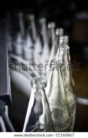 empty bottles in a row - stock photo