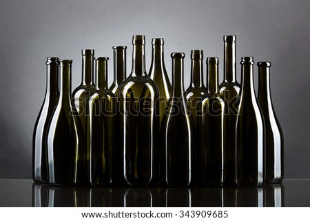 Empty bottles isolated over the gray background - stock photo