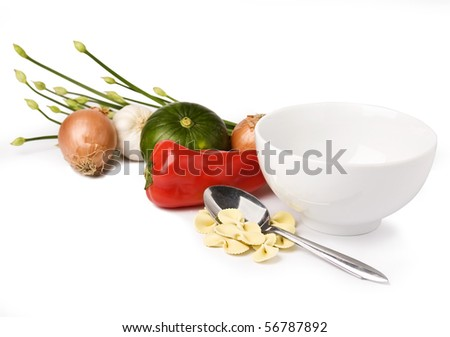 Empty bowl of soup with soup ingredients and spoon. Isolated on white. - stock photo