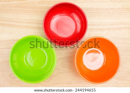 empty bowl on wooden table - stock photo