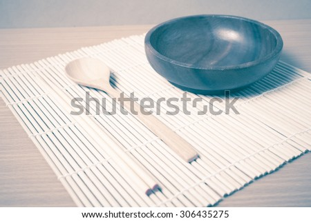 empty bowl with chopstick on wood table background vintage style - stock photo