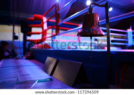 Empty boxing ring and bell - stock photo