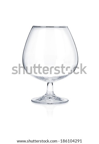 Empty brandy cognac glass isolated on white background - stock photo