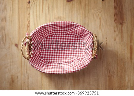 empty bread basket with red and white checkered cloth - stock photo