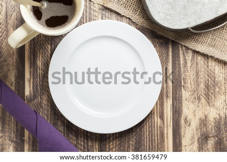 empty breakfast plate background on vintage wood with coffee - stock photo