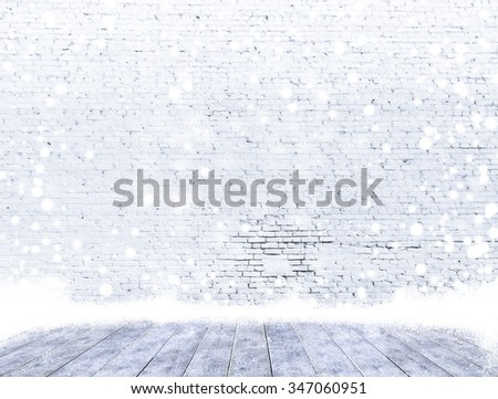 empty brick wall with ice cover a wooden floor and snowing ,Ready for product display montage. - stock photo