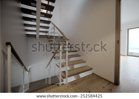 empty bright room with three windows and tiles  - stock photo