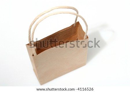 Empty brown paperbag isolated on white, perfect to put your design on the side - stock photo