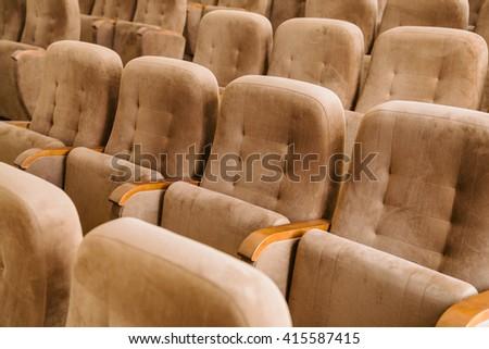 Empty brown velvet cinema seats - stock photo
