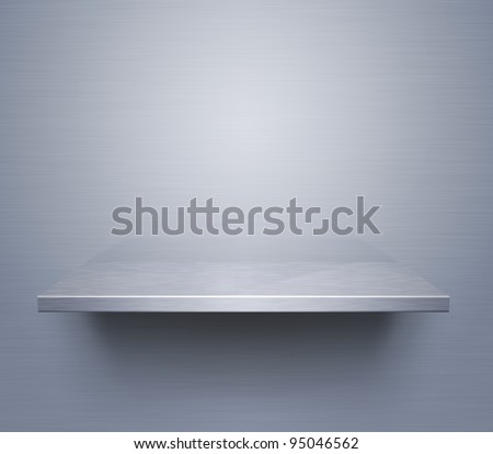 Empty brushed metal shelf at the wall - stock photo