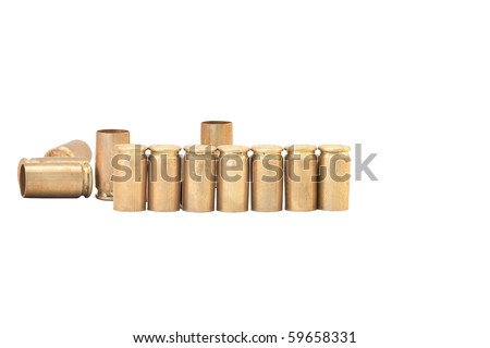 Empty bullets casings over white background - stock photo