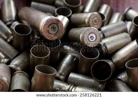 Empty Bullets / Rounds on top of the Wood Table - stock photo