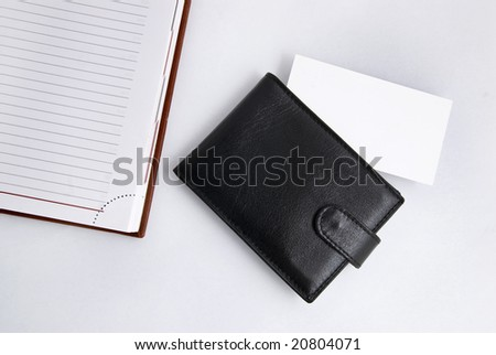 Empty business card with diary and card holder - stock photo