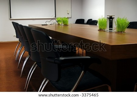 empty business conference room, room is modern and has trendy design elements - stock photo