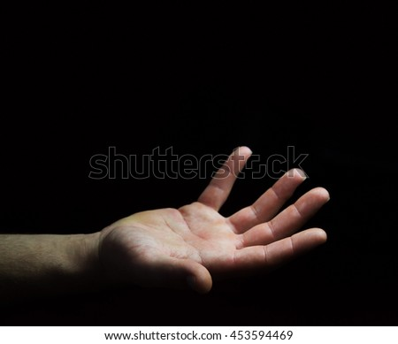 Empty businessman hand on black dark background office