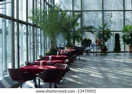 empty cafe interior and palm trees - stock photo