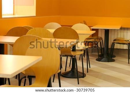 empty cafe interior orange color - stock photo