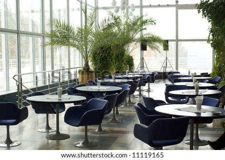 Empty cafe interior with stage waiting for customers - stock photo