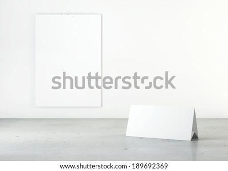 Empty calendars on white wall and concrete floor - stock photo