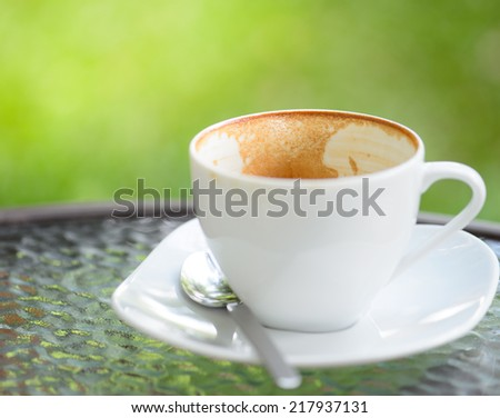 empty cappuccino coffee cup - stock photo