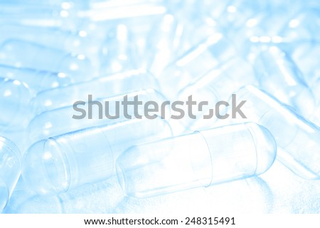 Empty capsules for background  with reflector. - stock photo