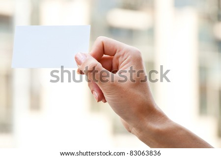 empty card in a hand on a blur background