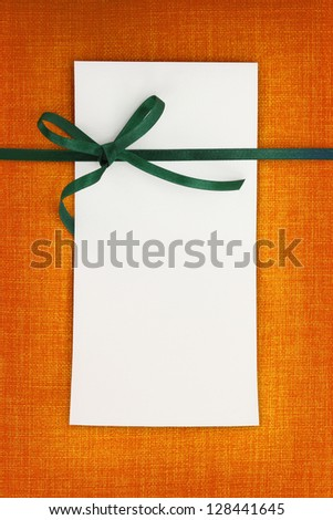 Empty card on fabric texture background - stock photo
