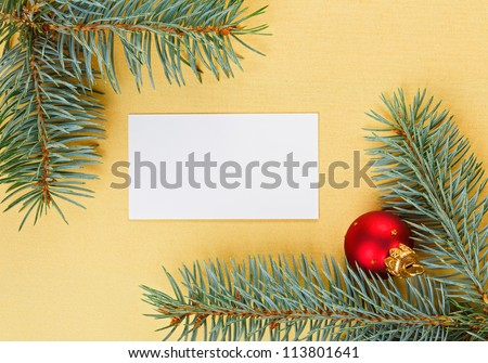 Empty card on golden Christmas background with spruce branches - stock photo