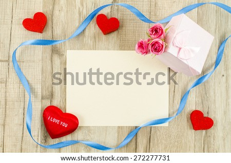 Empty card with rose flower, gift box, heart and ribbon - stock photo